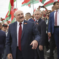Belarusian President Alexander Lukashenko speaks with people after the wreath laying ceremony at Mound of Glory war memorial marking Independence Day, on the outskirts of the capital Minsk, Belarus, July 3, 2021. (Maxim Guchek/BelTA Pool Photo via AP)