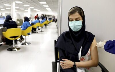 A medical worker gives the Sinopharm coronavirus vaccine at the Iran Mall shopping center in Tehran, Iran, May 17, 2021. (AP Photo/Ebrahim Noroozi, File)