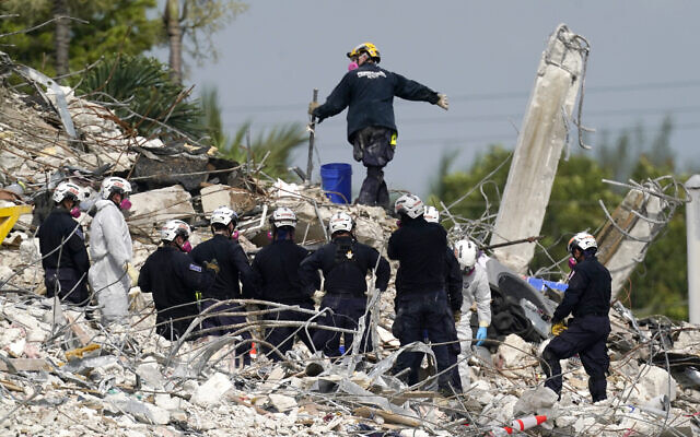 Rescue crews work at the site of the collapsed Champlain Towers South condo building after the remaining structure was demolished Sunday, in Surfside, Florida, on Monday, July 5, 2021. (AP Photo/Lynne Sladky)