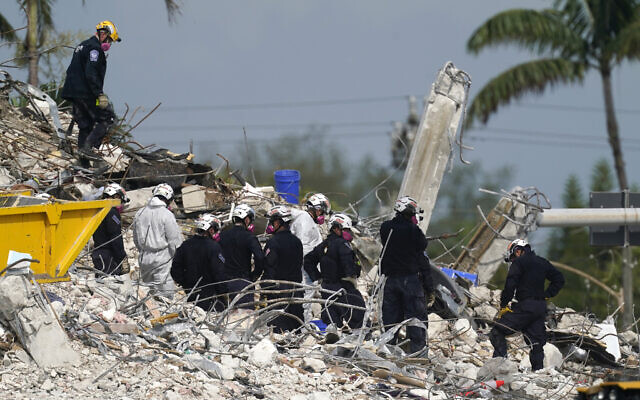 Rescue crews work at the site of the collapsed Champlain Towers South condo building after the remaining structure was demolished Sunday, in Surfside, Fla., Monday, July 5, 2021. (AP Photo/Lynne Sladky)