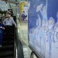 A poster hoping to overcome the COVID-19 crisis is displayed at a train station in Seoul, South Korea, Tuesday, July 6, 2021. (AP/Ahn Young-joon)