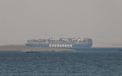 The Ever Given, a Panama-flagged cargo ship, is seen in Egypt's Great Bitter Lake, March 30, 2021. (AP Photo/Mohamed Elshahed, File),