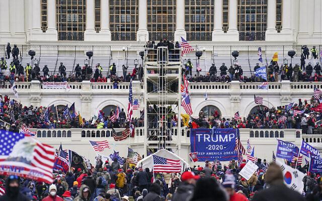 Insurrectionist supporters of then US president Donald Trump breach the Capitol in Washington, January 6, 2021. (AP Photo/John Minchillo, File)