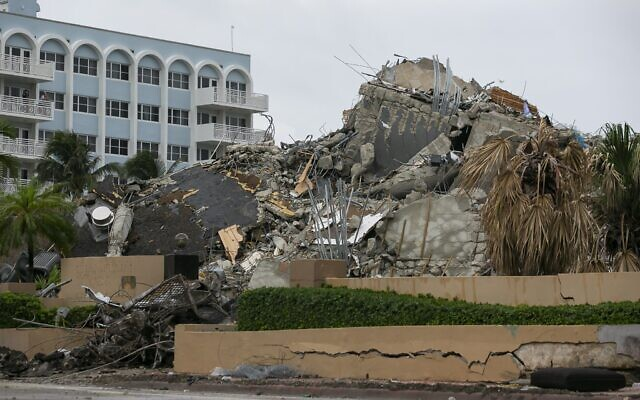 Rubble and debris of the Champlain Towers South condo can be seen Tuesday, July 6, 2021 in Surfside, Florida (Carl Juste/Miami Herald via AP)