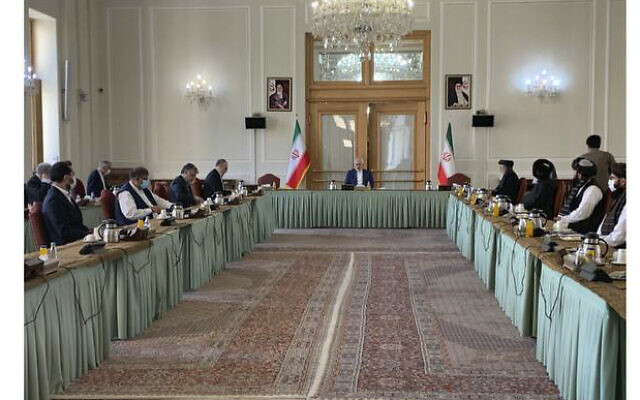 This photo released by the Iranian Foreign Ministry, shows a meeting between two delegations from Taliban and government of Afghanistan hosting by Iranian Foreign Minister Mohammad Javad Zarif, in Tehran, Iran, Wednesday, July 7, 2021 (Iranian Foreign Ministry via AP)