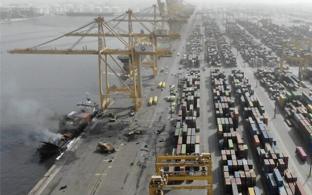 This photo made available from a Government of Dubai Media Office's footage, shows the smoke from a container ship, Ocean Trader, on Thursday, July 8, 2021 after there was an explosion on Wednesday night.  (Government of Dubai Media Office via AP)