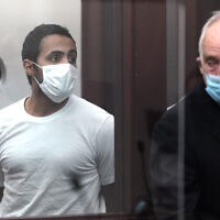 Khaled Awad, left, appears in Brighton District Court in Boston on July 8, 2021, for a dangerousness hearing. Awad has been charged with stabbing Rabbi Shlomo Noginski several times near a Jewish day school. (AP Photo/Elise Amendola, Pool)