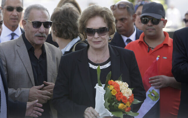 In this Oct. 6, 2015, photo, Jehan Sadat, widow of assassinated Egyptian president Anwar Sadat, lays a wreath at his tomb inside the memorial of the Unknown Soldier in Cairo, Egypt, marking the 42th anniversary of the Oct. 6 Arab-Israeli war in 1973. (AP Photo/Amr Nabil)