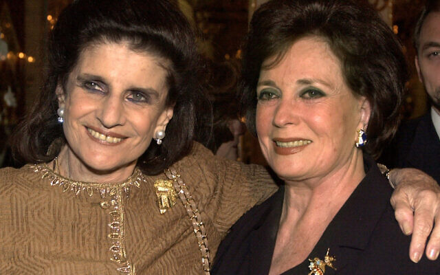 """In this May 22, 2000, photo, Leah Rabin, left, widow of slain Israeli Prime Minister Yitzhak Rabin, poses with Jehan Sadat, widow of assassinated Egyptian President Anwar Sadat at a reception before being honored at the """"Broadway Salutes Seeds of Peace and the Peacemakers"""" gala at New York's Carnegie Hall. (AP Photo/Ron Frehm, File)"""