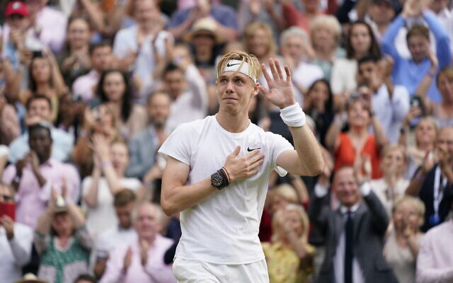 Canada's Denis Shapovalov acknowledges the crowd after being defeated by Serbia's Novak Djokovic during the men's singles semifinals match on day eleven of the Wimbledon Tennis Championships in London, July 9, 2021. (AP Photo/Alberto Pezzali)