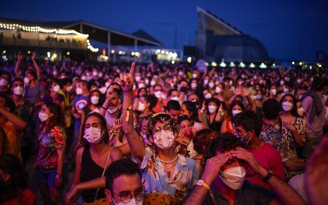 People attend the Cruilla music festival in Barcelona, Spain, July 9, 2021. (AP Photo/Joan Mateu)