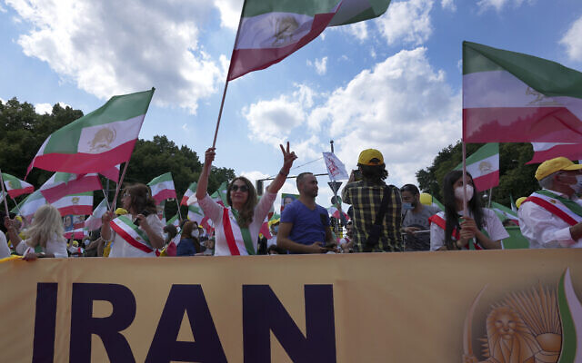 People attend a protest rally as part of the 'Free Iran World Summit 2021' in Berlin, Germany, July 10, 2021  (Michael Sohn/AP)