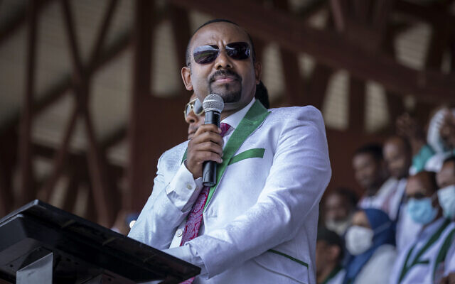 Ethiopian Prime Minister Abiy Ahmed speaks at a final campaign rally at a stadium in the town of Jimma in the southwestern Oromia Region of Ethiopia, on June 16, 2021. (AP Photo/Mulugeta Ayene, File)