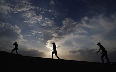 People walk along a trail, July 11, 2021, in Death Valley National Park, California (AP/John Locher)