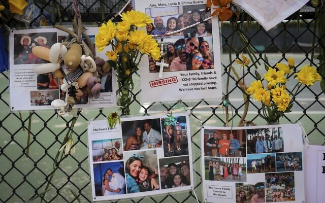 A memorial for the Guara family is posted on a fence near the Champlain Towers South, in Surfside, Florida, July 6, 2021. (Carl Juste/Miami Herald via A)