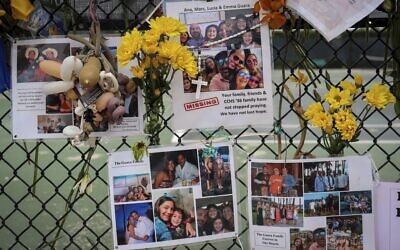 In this July 6, 2021, file photo, a memorial for the Guara family is posted on a fence near the Champlain Towers South, in Surfside, Florida (Carl Juste/Miami Herald via AP, File)