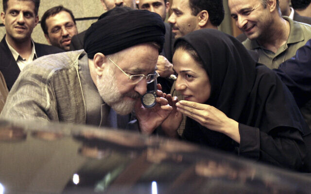 In this July 13, 2005, file photo, outgoing reformist Iranian President Mohammad Khatami talks on the phone with the mother of female journalist Masih Alinejad, right, after meeting with journalists in Tehran, Iran. Prosecutors in the US alleged Tuesday, July 13, 2021, that Iran planned to kidnap Alinejad, famous for her campaign against the Islamic Republic's mandatory headscarf, or hijab, for women. Iran did not immediately comment on the allegation Wednesday, July 14, 2021. (AP Photo/Hasan Sarbakhshian, File)
