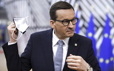 Poland's Prime Minister Mateusz Morawiecki speaks with the media as he arrives for an EU summit at the European Council building in Brussels, on May 24, 2021. (Olivier Hoslet, Pool via AP, File)