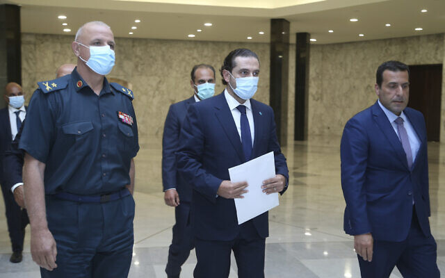 Lebanese Prime Minister-Designate Saad Hariri, center, arrives to his meeting with Lebanese President Michel Aoun at the presidential palace, in Baabda, east of Beirut, Lebanon, on July 14, 2021. (Dalati Nohra/Lebanese Official Government via AP)