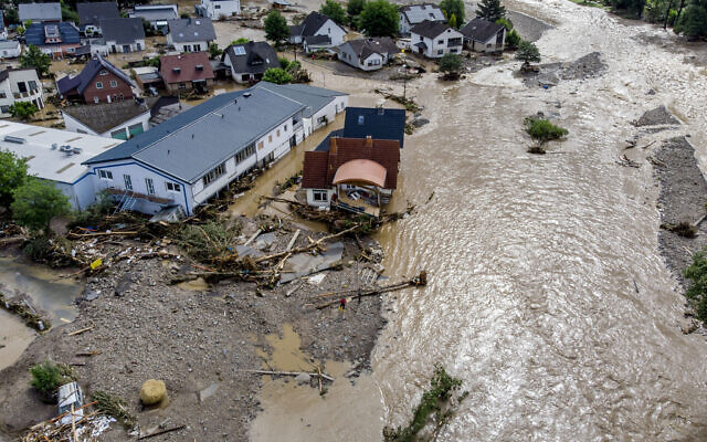 Damaged houses are seen at the Ahr river in Insul, western Germany, Thursday, on July 15, 2021. (AP Photo/Michael Probst)