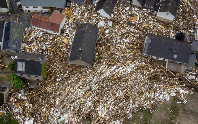 Debris of houses and trees surround houses in Schuld, Germany, July 16, 2021 (AP Photo/Michael Probst)