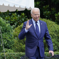US President Joe Biden tries to hear questions shouted by reporters as he heads to Marine One on the South Lawn of the White House in Washington, July 16, 2021, to spend the weekend at Camp David. (AP Photo/Susan Walsh)