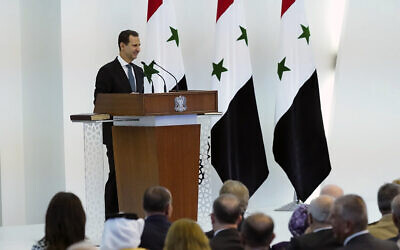 In this photo released by the official Facebook page of the Syrian Presidency, Syrian President Bashar Assad takes the oath of office for a fourth seven-year term, at the Syrian Presidential Palace in the capital Damascus, Syria, July 17, 2021 (Syrian Presidency via Facebook via AP)