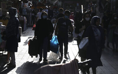 People walk around in a commercial district in downtown Tehran, Iran, July, 17, 2021. (AP Photo/Vahid Salemi)