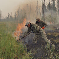 Volunteers douse a forest fire in the republic of Sakha also known as Yakutia, Russia Far East, July 17, 2021. (AP/Ivan Nikiforov)