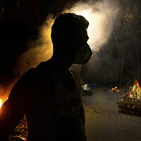 Illustrative: In this Septsember 14, 2020, file photo, Ramananda Sarkar, 43, who has cremated more than 450 COVID-19 victims stands by burning funeral pyres of COVID-19 victims in Gauhati, India. (AP Photo/Anupam Nath, File)