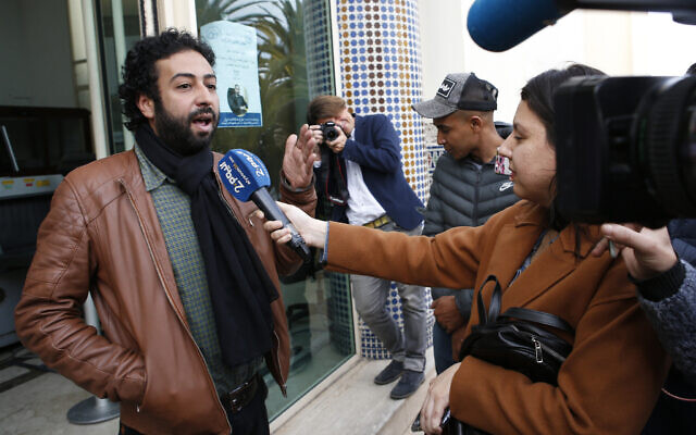 Journalist and activist Omar Radi speaks after a hearing at the Casablanca Courthouse, in Casablanca, Morocco, March 5, 2020. (AP Photo/Abdeljalil Bounhar, File)
