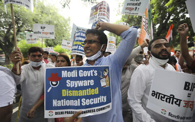 Congress party workers shout slogans during a protest accusing Prime Minister Narendra Modi's government of using military-grade spyware to monitor political opponents, journalists and activists in New Delhi, India, on July 20, 2021. (AP Photo/Manish Swarup)