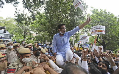 Congress party workers shout slogans during a protest accusing Prime Minister Narendra Modi's government of using military-grade spyware to monitor political opponents, journalists and activists in New Delhi, India, Tuesday, July 20, 2021. (AP/Manish Swarup)
