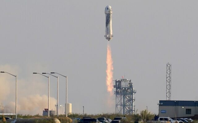 Blue Origin's New Shepard rocket launches carrying passengers Jeff Bezos, founder of Amazon and space tourism company Blue Origin, brother Mark Bezos, Oliver Daemen and Wally Funk, from its spaceport near Van Horn, Texas, July 20, 2021. (AP Photo/Tony Gutierrez)