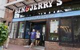 Two patrons enter the Ben & Jerry's Ice Cream shop, July 20, 2021, in Burlington, Vermont. (AP Photo/Charles Krupa)