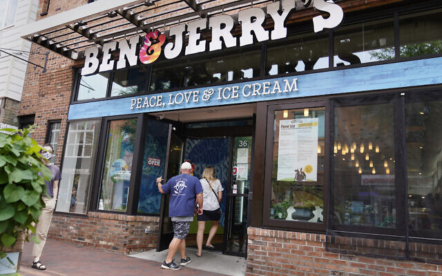 Two patrons enter the Ben & Jerry's Ice Cream shop in Burlington, Vermont, on, July 20, 2021. (AP Photo/Charles Krupa)