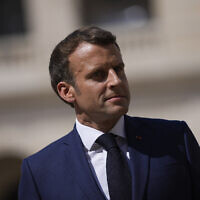 French President Emmanuel Macron attends a farewell ceremony for the French armed forces chief of staff, Gen. Francois Lecointre, at the Invalides monument in Paris, on July 21, 2021. (Daniel Cole/AP)