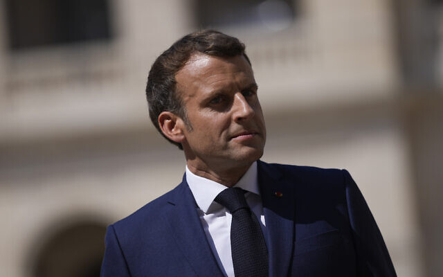 French President Emmanuel Macron attends a farewell ceremony for the French armed forces chief of staff, Gen. Francois Lecointre at the Invalides monument in Paris, July 21, 2021. (Daniel Cole/AP)