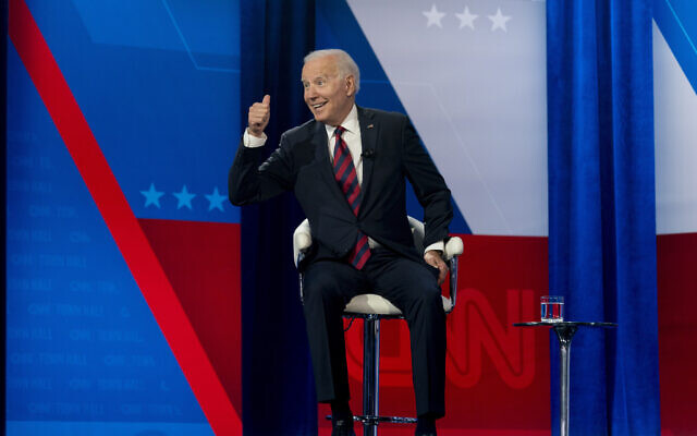 US President Joe Biden interacts with members of the audience during a commercial break for a CNN town hall at Mount St. Joseph University in Cincinnati, July 21, 2021. (Andrew Harnik/AP)