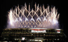 Fireworks illuminate over the National Stadium during the opening ceremony of the 2020 Summer Olympics, Friday, July 23, 2021, in Tokyo. (AP Photo/Shuji Kajiyama)