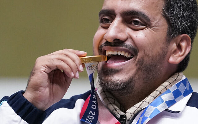 Javad Foroughi of Iran celebrates after winning the gold medal in the men's 10-meter air pistol at the Asaka Shooting Range in the 2020 Summer Olympics, Saturday, July 24, 2021, in Tokyo, Japan. (AP Photo/Alex Brandon)