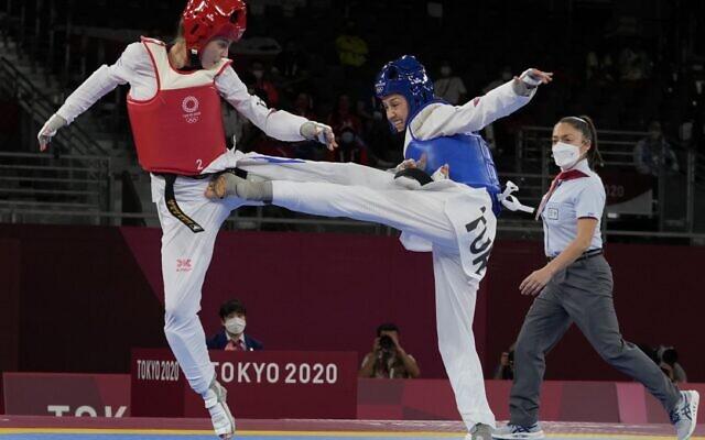 Israel's Avishag Semberg, left, competes with Turkey's Rukiye Yıldırım during the women's 49kg taekwondo match at the 2020 Summer Olympics, on Saturday, July 24, 2021, in Tokyo, Japan. (AP Photo/Themba Hadebe).