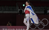 Israel's Avishag Semberg walks off the ring after defeating Turkey's Rukiye Yıldırım to win a bronze medal during the women's 49kg taekwondo match at the 2020 Summer Olympics, Saturday, July 24, 2021, in Tokyo, Japan. (AP Photo/Themba Hadebe).