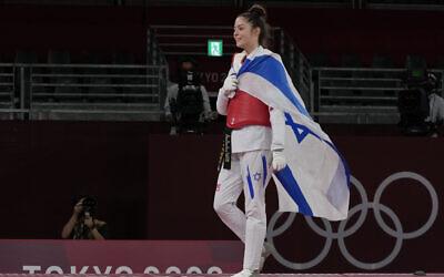 Israel's Avishag Semberg walks off the ring after defeating Turkey's Rukiye Yıldırım to win a bronze medal during the women's 49kg taekwondo match at the 2020 Summer Olympics, on Saturday, July 24, 2021, in Tokyo, Japan. (AP Photo/Themba Hadebe).