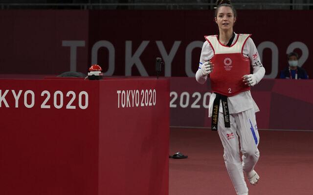 Israel's Avishag Semberg celebrates after defeating Turkey's Rukiye Yıldırım to win a bronze medal during the women's 49kg taekwondo match at the 2020 Summer Olympics, on Saturday, July 24, 2021, in Tokyo, Japan. (AP/Themba Hadebe).