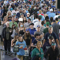Fan file through the main concourse of T-Mobile Park before a baseball game between the Seattle Mariners and the Oakland Athletics, Saturday, July 24, 2021, in Seattle. (AP/Ted S. Warren)