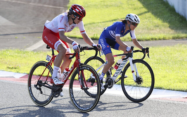 Anna Plichta of Poland and Omer Shapira of Israel compete in the women's cycling road race at the 2020 Summer Olympics, Sunday, July 25, 2021, in Oyama, Japan. (Michael Steele/Pool Photo via AP)