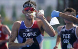 Dorian Coninx of France takes water as a volunteer holds out a bag of ice, during the run portion of the men's individual triathlon at the 2020 Summer Olympics, July 26, 2021, in Tokyo, Japan. (AP Photo/Jae C. Hong)