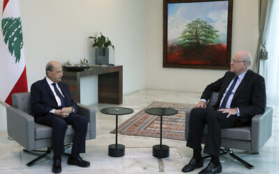 Lebanese President Michel Aoun, left, meets with former Lebanese Prime Minister Najib Mikati, at the presidential palace, in Baabda, east of Beirut, Lebanon, July 26, 2021. (Dalati Nohra/Lebanese Official Government via AP)