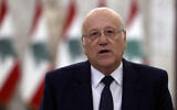 Lebanese Prime Minister-designate Najib Mikati, speaks to journalists after his meeting with Lebanese President Michel Aoun, at the Presidential Palace in Baabda, east of Beirut, Lebanon, July 26, 2021. (AP Photo/Bilal Hussein)